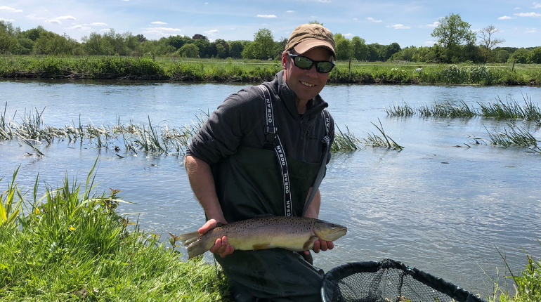 James Morgan the game keeper helping stock fish